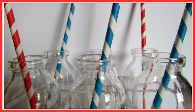 Vintage school milk bottles with stripy straws