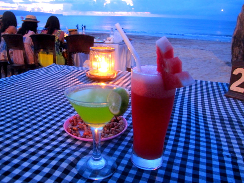 Delicious drinks & candle night dinner at Jimbaran Beach