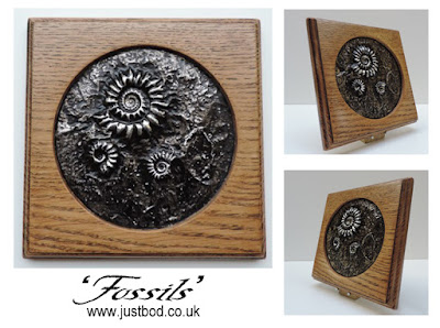 Fossils sculpted wall plaque by Justbod