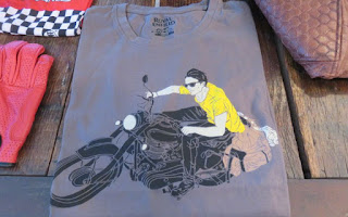 T-shirt with artwork of man riding a Royal Enfield.