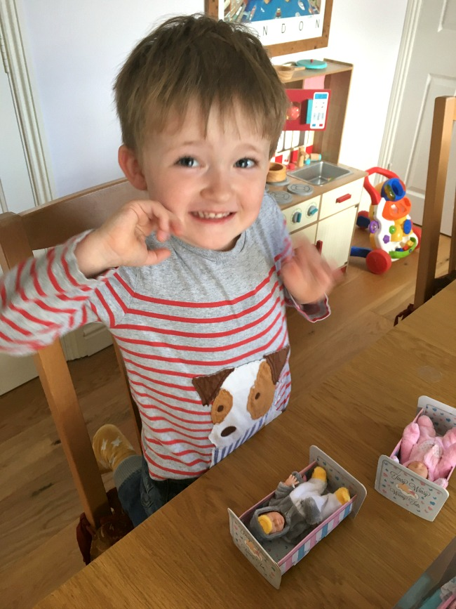 boy-looking-happy-with-Tinsy-winsy-weeny-tot-doll-pram-dolls