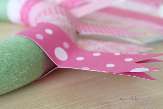 wrap paper strips around wreath form