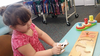 grandkid fun, fun with kids, our girl is growing up, love this child, smart girl, wooden puzzle, library time