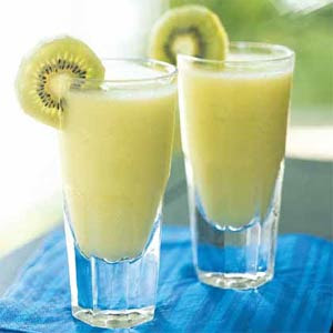 This Kiwi Colada is perfect for St. Patrick's Day or any Spring event. This drink presents beautifully and has a wonderful flavor! #stpatricksday #greendrinks #coladarecipe #kiwidrink