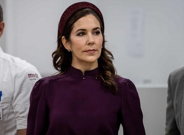 Crown Princess Mary attended the opening of Viborg Regional Hospital's new emergency center. burgundy blouse, grey midi dkirt, grey wool coat