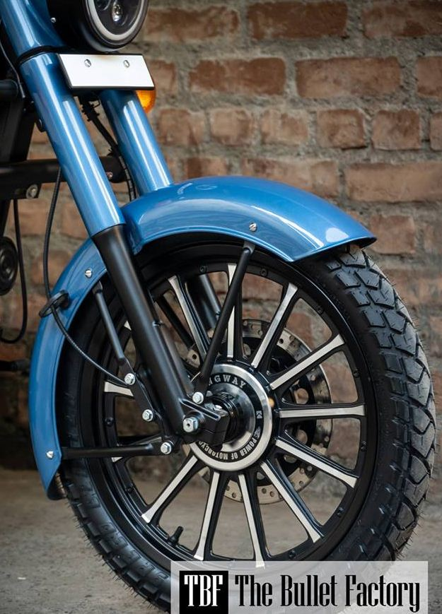 Also ordinary alloy wheels are removed and king way alloy is used,in handle bar section wider handlebar with Bar end mirror used,fitted with a custom fender,also fitted custom seats,coming with exhaust,yes also they used red rooster silencer.