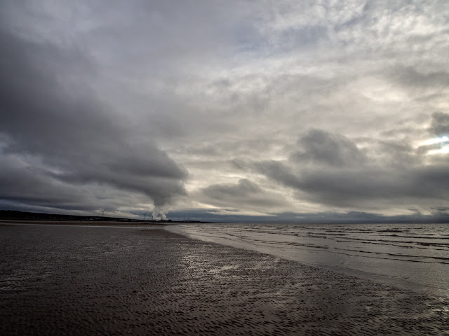 Photo of a stormy sky on the shore at Maryport looking towards Iggesund paperboard mill at Workington