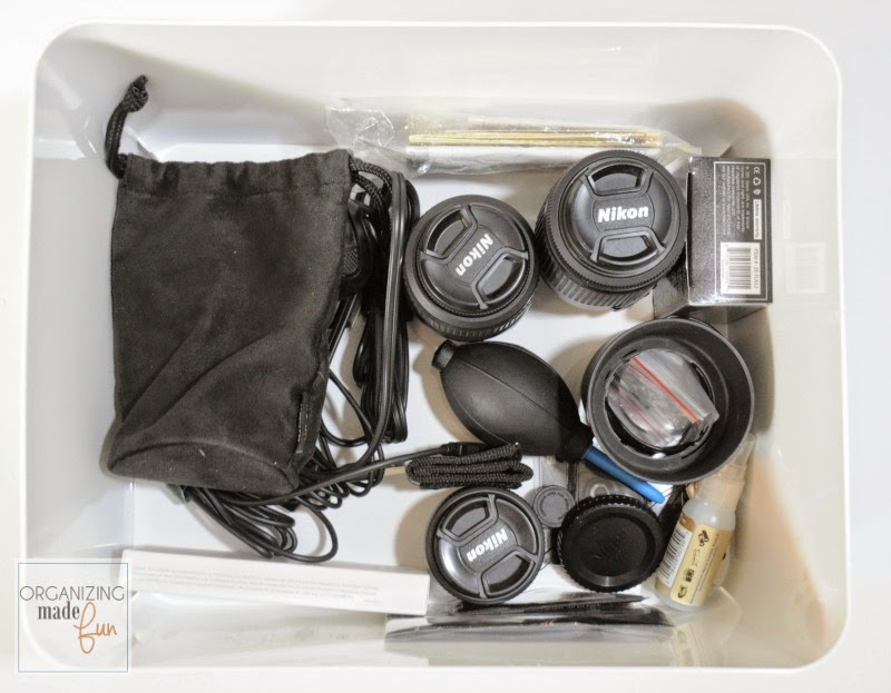 Camera lenses organized inside an Ikea containers on open shelving :: OrganizingMadeFun.com