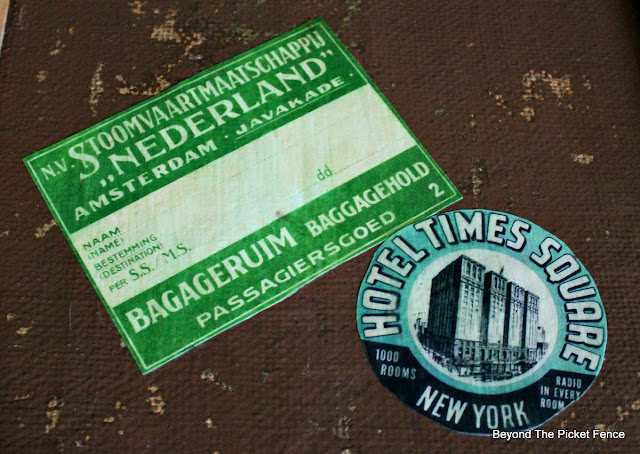 decoupage vintage travel tags on an old trunk