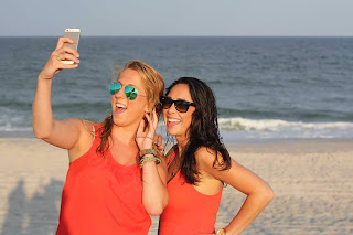 Two woman taking a selfie video for marketing