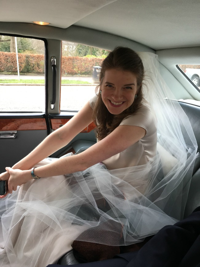 #MySundayPhoto is a picture of a bride with veil and smiling in a vintage car