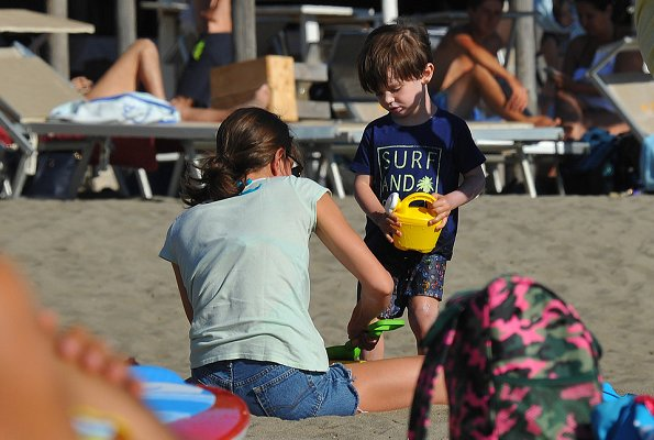 Charlotte Casiraghi and son, Raphaël Casiraghi Elmaleh on the beach in Tuscany news holiday fashion style