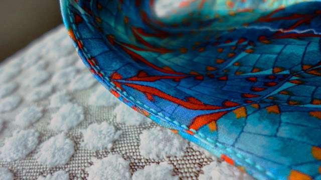 Understitching fabric neckline facing