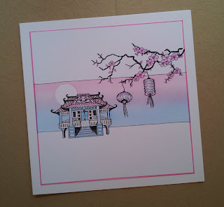 Pink and blue panel card with pagoda, cherry blossom and lanterns