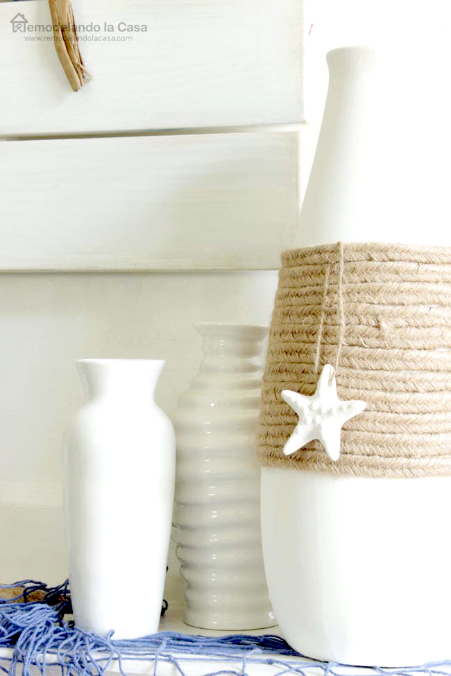 rope around center of white vase with starfish decoration