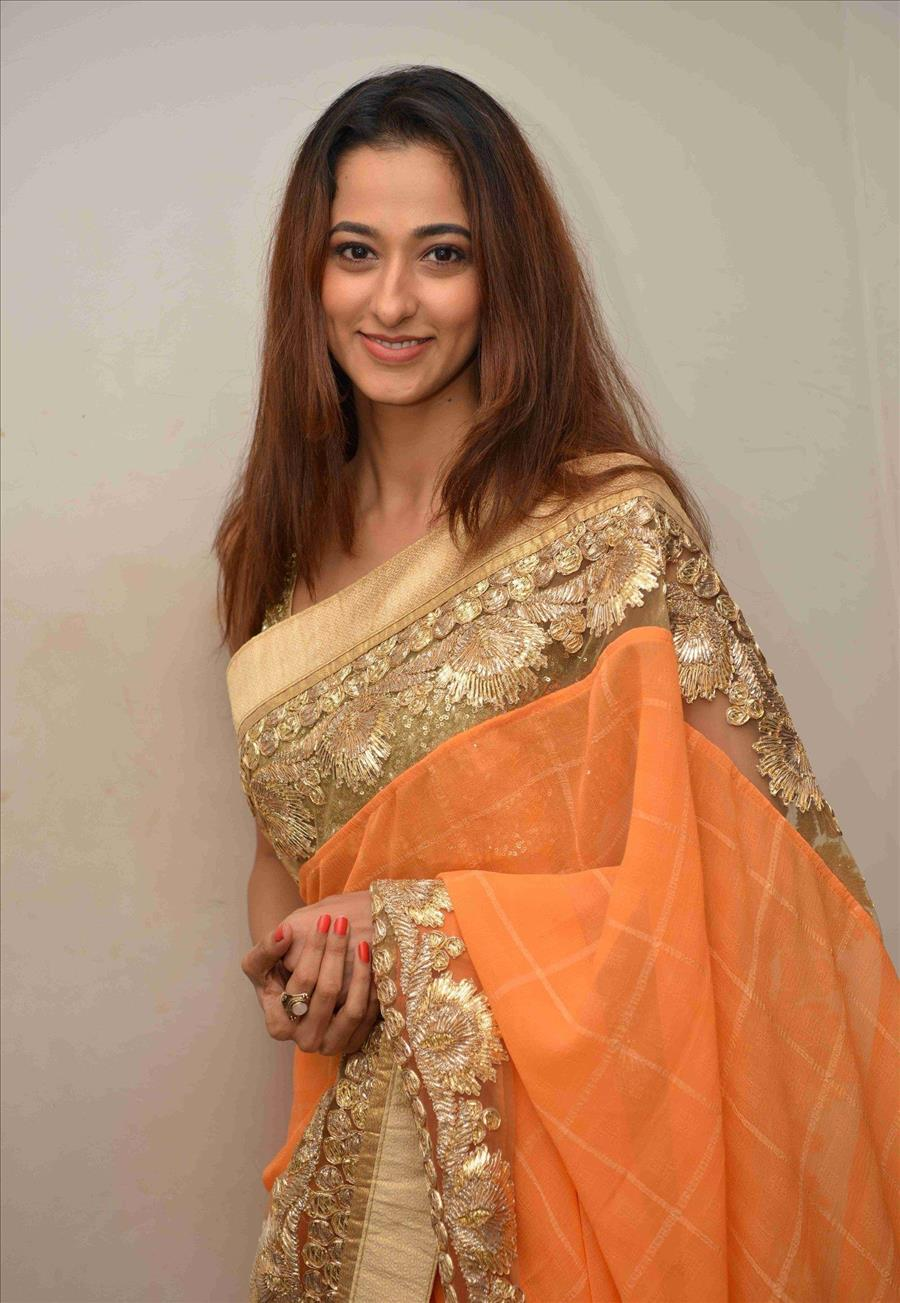 Beautiful Indian Girl Radhika Chetan In Sleeveless Orange Saree