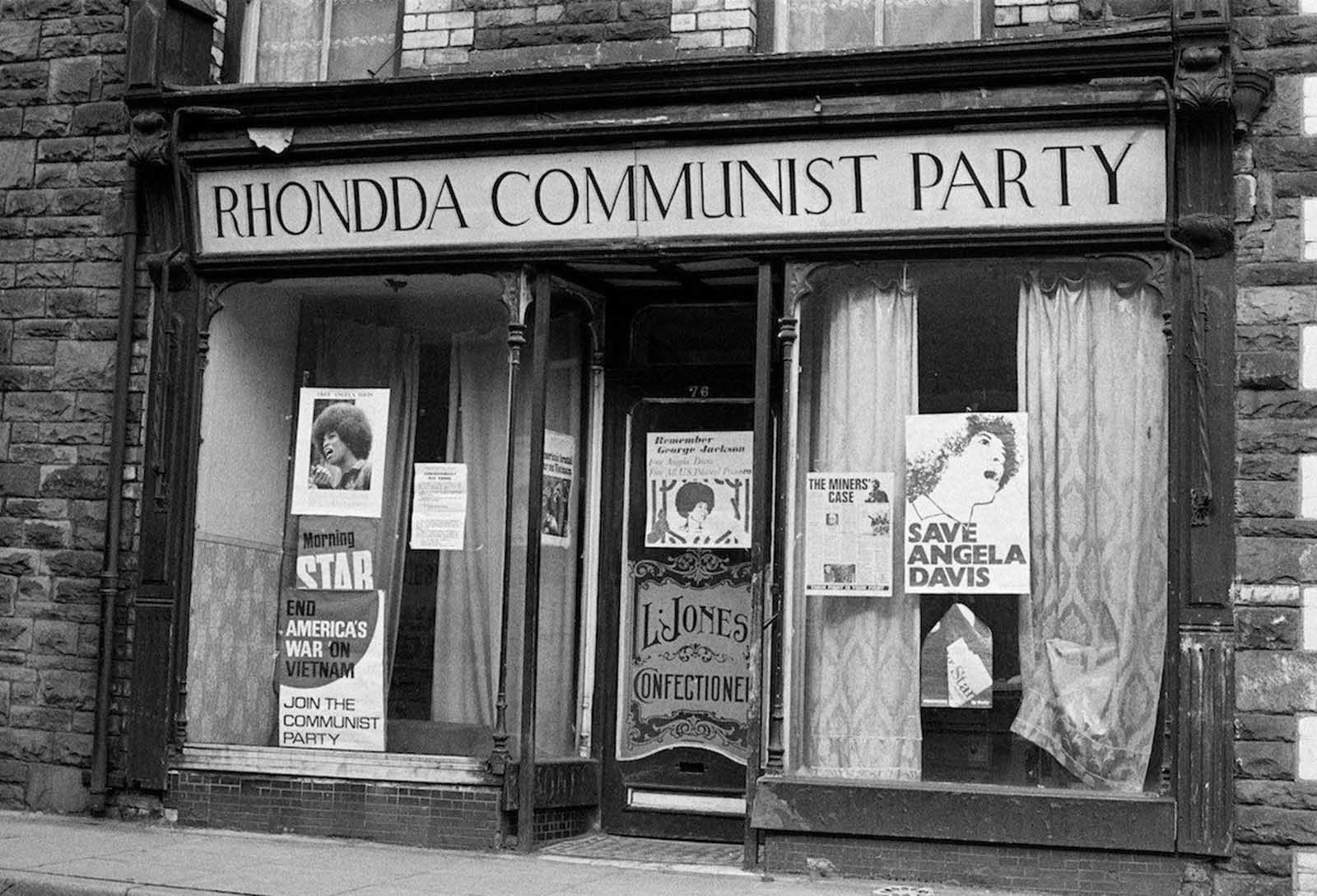 The headquarters of the Rhondda Communist Party in Wales. In the windows are posters of American political activist Angela Davis. 1972.