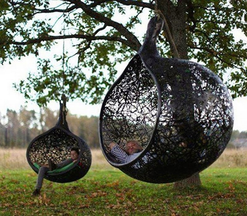 15. Hanging chairs made by artist Maffam Freeform allow you to hang out in your garden like never before. - 21 Places to Take a Nap Straight Out Of Your Fantasies