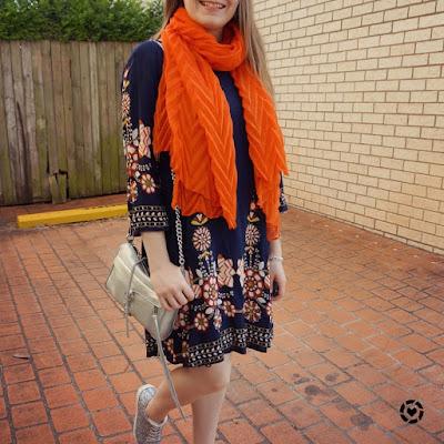 awayfromtheblue instagram | navy floral swing dress orange crinkle scarf silver bag and glitter shoes