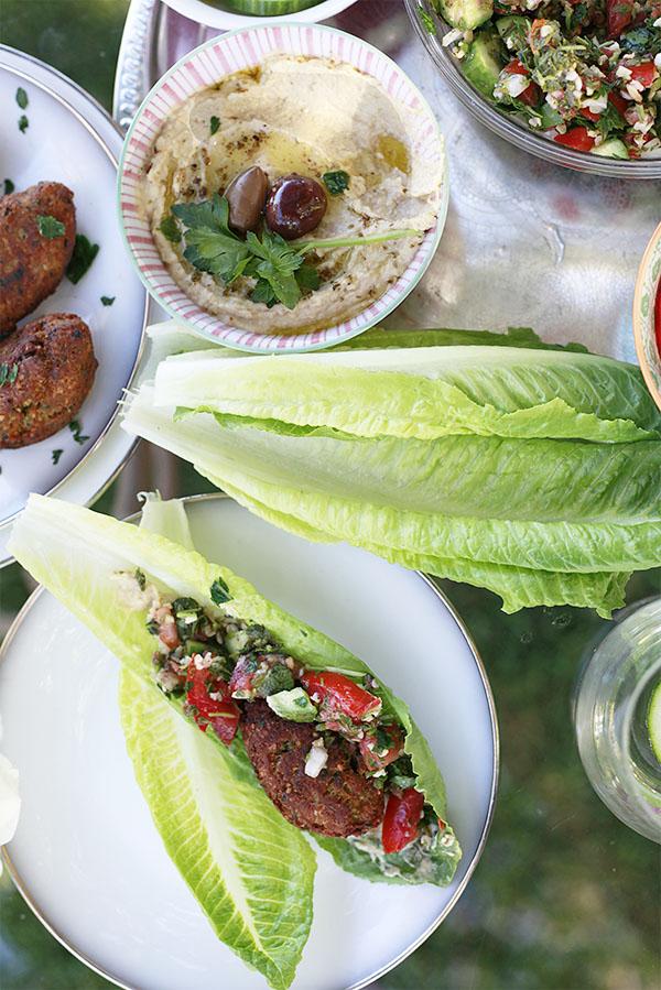Vegan lettuce wraps with falafel, hummus, and tabbouleh