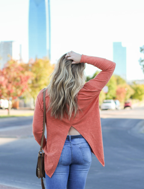 blonde girl wearing free people split back turtleneck