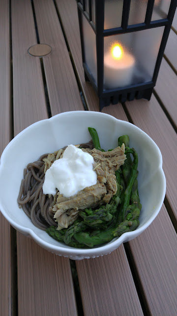pulled pork served on top of soba noodles and asparagus