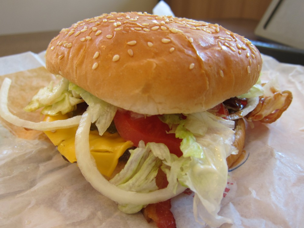 Burger Kings New BBQ Bacon Whopper Features A Quarter Pound Flame Grilled Beef Patty Thick Cut American Cheese Iceberg Lettuce Tomatoes Onions