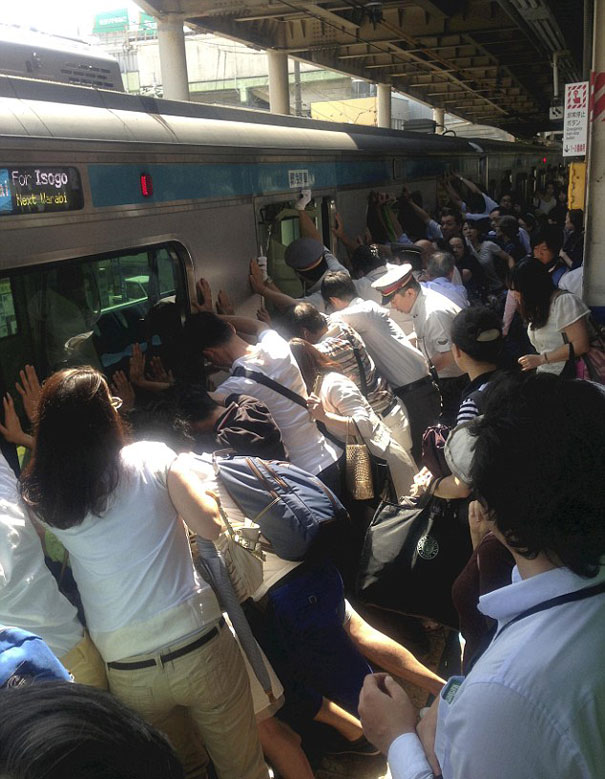 Dozens of japanese train passengers pushed 32-ton train car away from platform to free woman trapped in gap.