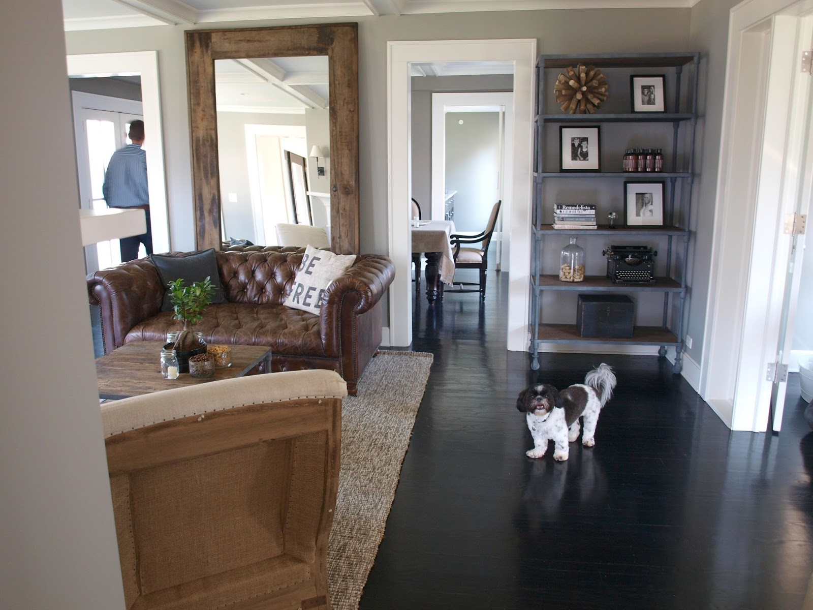 Modern farmhouse living room with black wood floors and open shelving - Hello Lovely Studio