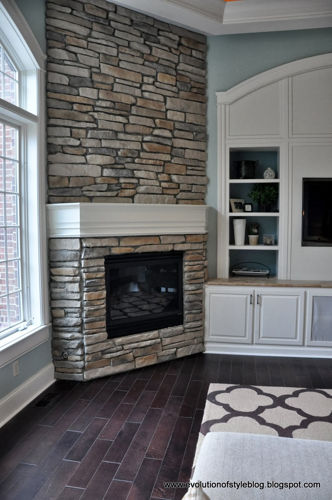 Diy stone fireplace reveal for real evolution of style for Building a corner fireplace