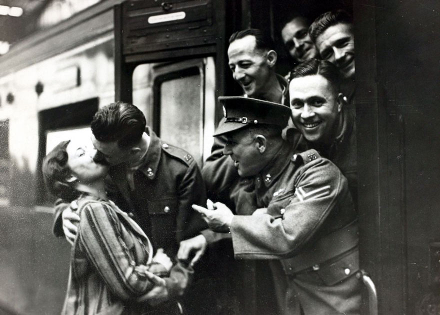 60 + 1 Heart-Warming Historical Pictures That Illustrate Love During War - Comrades Heckle Soldier Kissing His Girlfriend Goodbye Before Leaving Waterloo Station, London, 1939