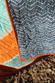 Colorblock baby boy quilt with fox fabric back of quilt