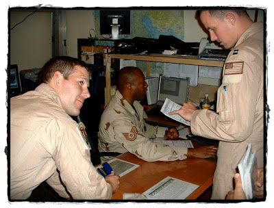 A KC-130 crew receiving their weather brief before they departed early on the morning of 9-11.