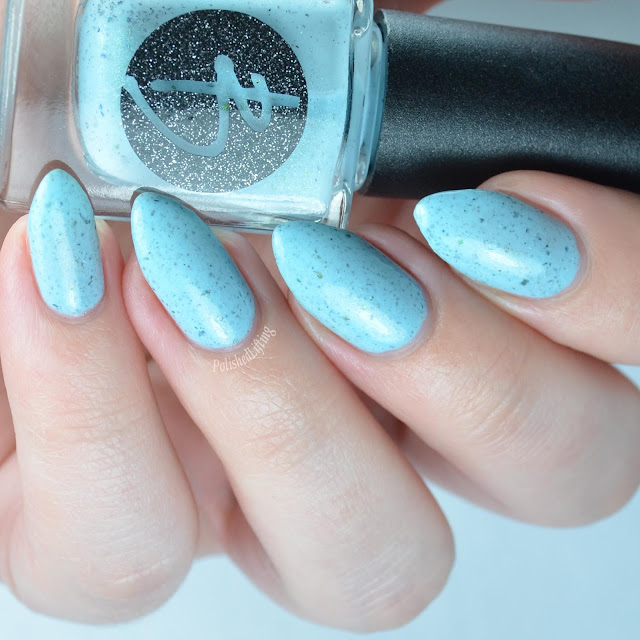 light blue nail polish with green shimmer