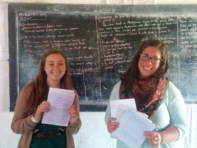 2 volunteers giving exam during tefl practice madagascar