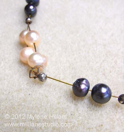 Multi strand freshwater pearl necklace with broken strand.