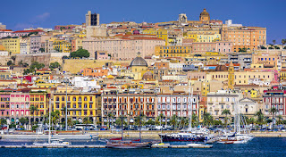 The port of Cagliari rises from the sea to provide a  colourful sight for approaching travellers