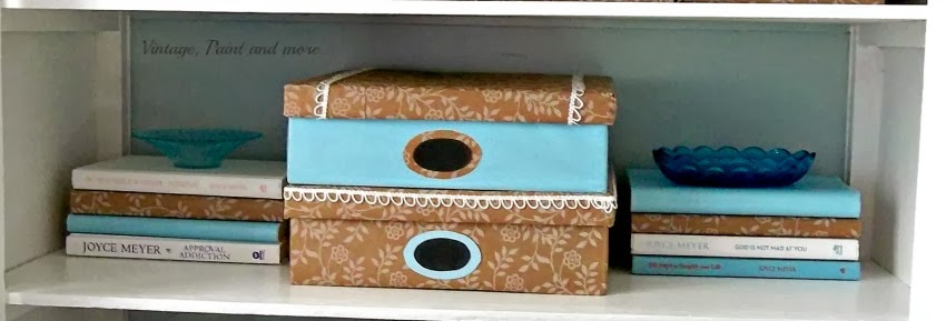 DIY Decorative Box Storage - image of second shelf of cabinet showing decorative box vignettes