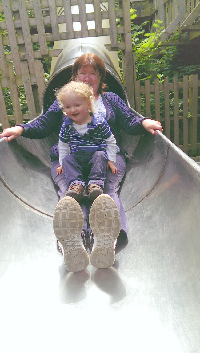 toddler-and-Nanny-happy-on-slide-at--Perrygrove-Railway-adventure-playground