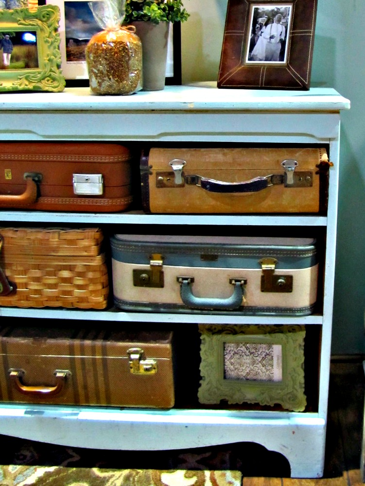 This array of vintage suitcases adds character to the shelves.