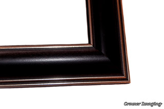 Cramer Imaging's photograph of a single navy blue colored plastic picture frame corner on a white background