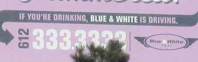Close up of the billboard showing it's for a cab company, looking for business from people who are drunk
