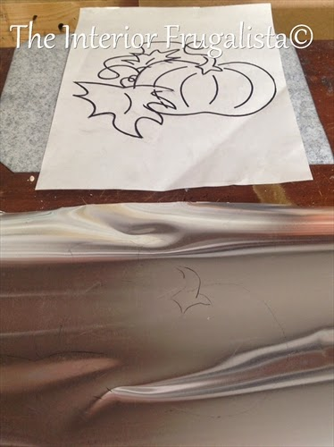 Tracing pumpkin image onto sheet metal for tin pumpkin art
