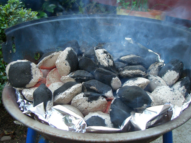 Glowing coals on a BBQ