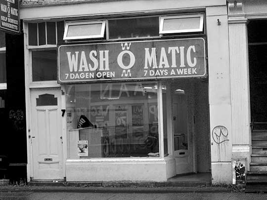 black and white photography, urban, city scene, launderette, shop, Amsterdam, Holland, travel,