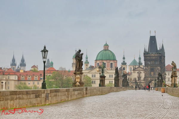 Setting the scene. Prague architecture viewed from across the Charles bridge, early morning. Lifestyle photography in Prague by Kent Johnson.