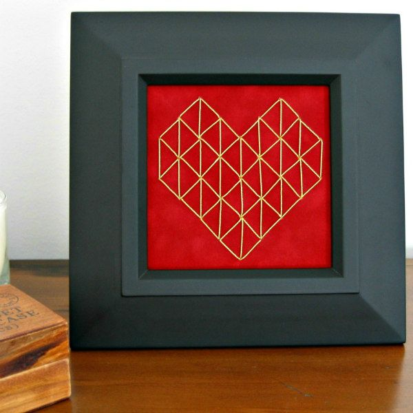 stitched geometric heart on red paper