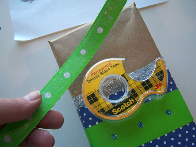 Use Double Sided Tape to adhere the ribbon.