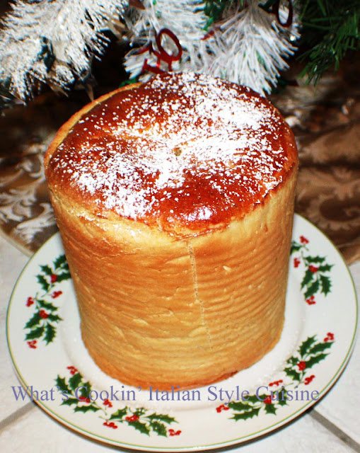 this is Pandoro made in a coffee can to look like a star and baked on a plate cooling with powdered sugar on top