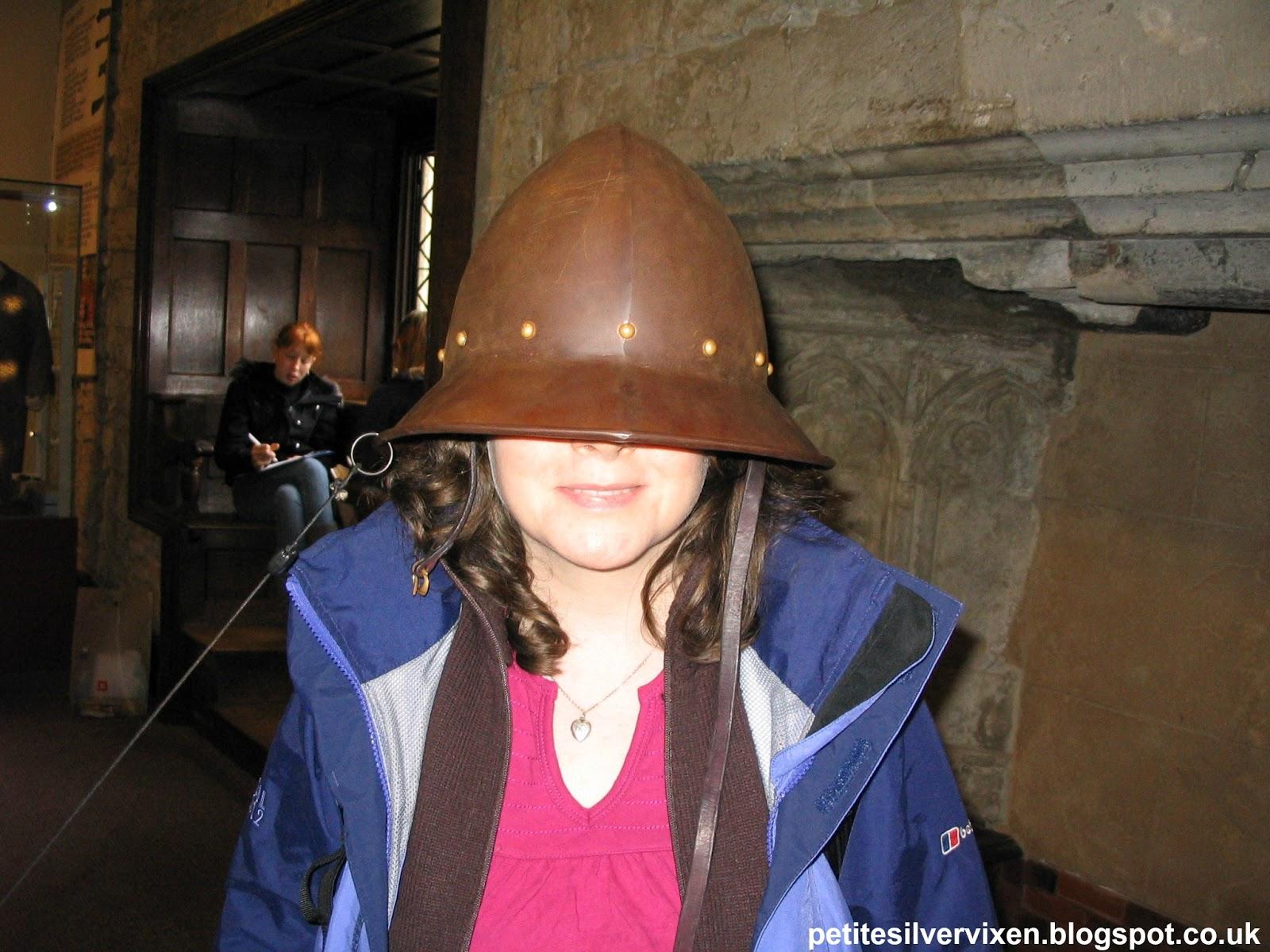 Petite Silver Vixen wearing a replica Cavalier Helmet covering eyes | Petite Silver Vixen